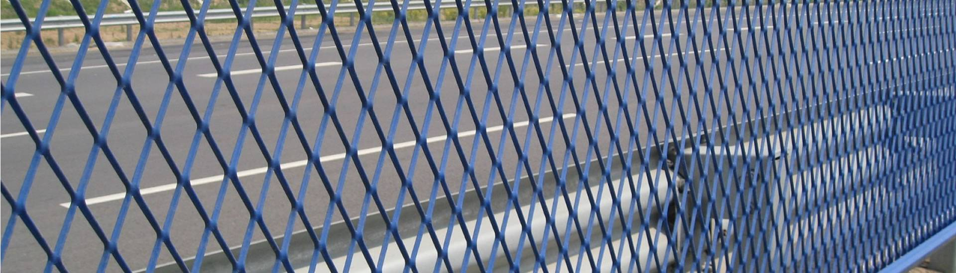 Blue expanded metal sheets are installed on the highway.