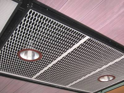 Decorative expanded metal is installed on the ceilings as vents and decoration.