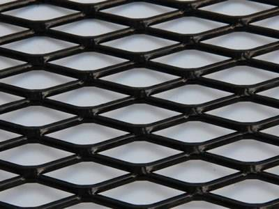 A black color decorative expanded metal mesh on the white background.