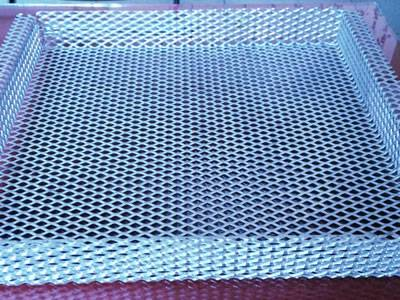 An folded aluminum expanded metal sheet on the table.