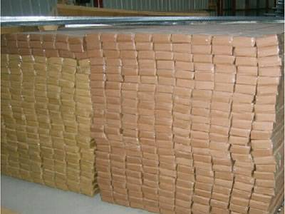 Several cartons of expanded corner bead in the warehouse.