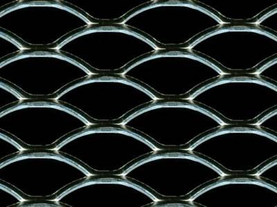 A piece of oval hole expanded metal car grill on the black background.