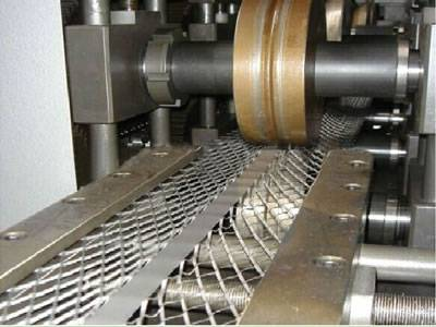 A machine is working for flattening the expanded metal corner bead.