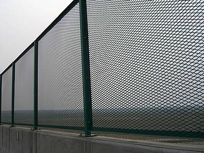 Expanded metal security fences are installed on the passageway of highway.