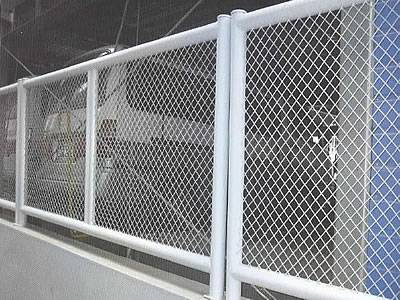 White expanded metal security fences are installed in the railway station.