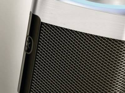 A piece of expanded metal speaker grill is covering the Bluetooth speaker.