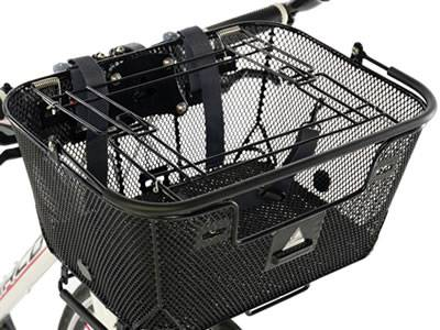A black flattened expanded metal basket is installed in the front of the bicycle.