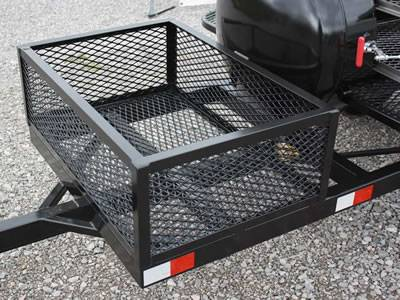 A black flattened expanded metal basket is installed on the truck.