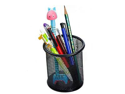 A black round pencil cup with several pencils in it.