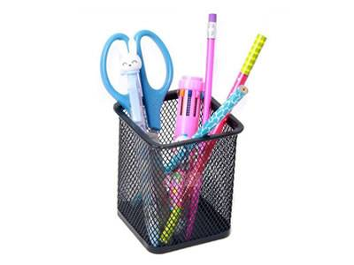 A black square pencil cup with several pencil and scissors in it.