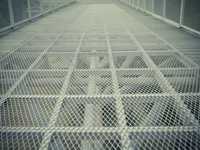 Galvanized raised expanded metal sheets are installed on the ground.
