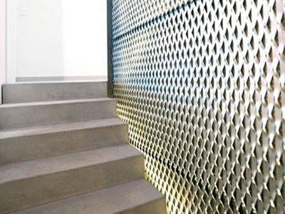 Galvanized raised expanded metal sheet are installed on the wall of stairs.
