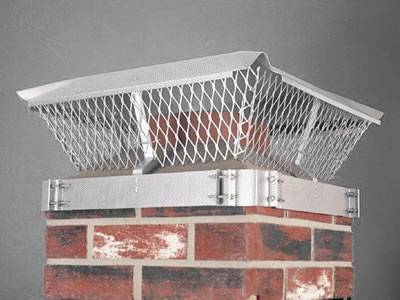 A stainless steel expanded metal chimney cap is covering the square chimney.